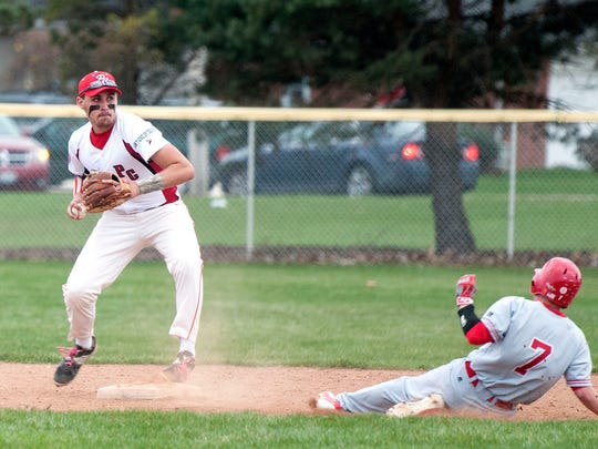 Port Clinton's Drew Fodor steps on second base to tag out Bellevue's Kyle Geary during Wednesday's game at Port Clinton.