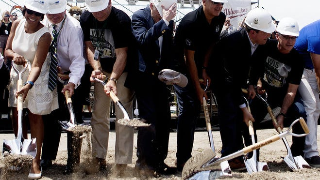 A ceremonial shovel flies out of former Sen.Herb Kohl's hands during the groundbreaking ceremony for the new Milwaukee Bucks arena at N. 4th St. and W. Juneau Ave. on Saturday.
