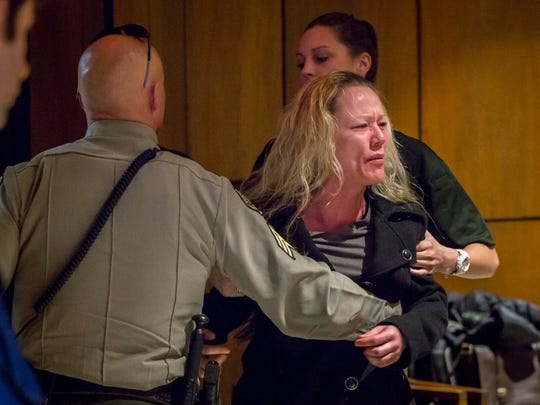 Audra Morgan is escorted out of court for an outburst during the sentencing of Dean Hilpipre, 61, at the Hardin County Courthouse, Friday, Feb. 23, 2018. Under a plea agreement, he received probation for molesting his at the time six-year-old granddaughter.