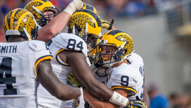 Michigan wide receiver Grant Perry, right, celebrates his third-quarter touchdown catch at the Citrus Bowl in Orlando on Jan. 1, 2016.
