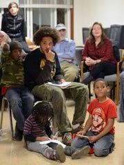 Jonathan Santos, a founding member of HoodTalk, at the forum in Klondyke Homes on Dec. 18.