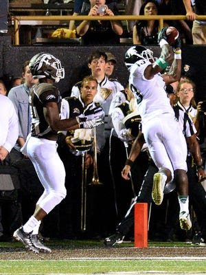 Vayante Copeland intercepts a fourth-quarter Zach Terrell pass in the end zone to stop a Bronco drive and seal the 37-24 victory for the Spartans Friday at Waldo Stadium in Kalamazoo.
