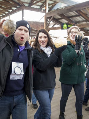 Participants in the Rutabaga Curling World Championship Saturday at The Ithaca Farmers Market.