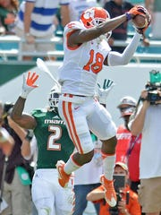 Clemson's Jadar Johnson (18) came up with an interception on Miami's first third-down play of the game last Saturday.
