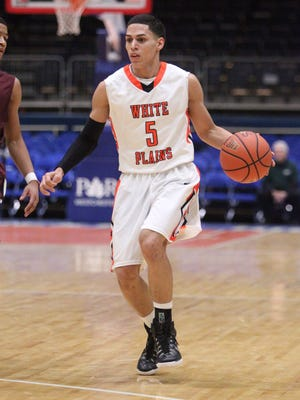 White Plains' Luis Cartagena against Kingston in the Slam Dunk tournament at the County Center on Dec. 26, 2014.