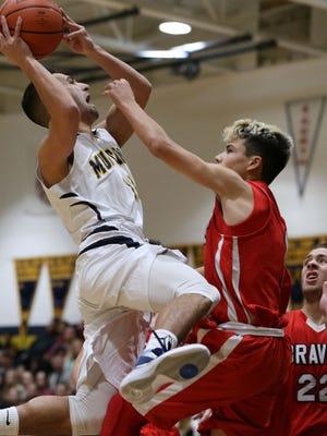 Marlboro's Noah Kiczales goes to the hoop as Manalapan's Rocky Garretson defends. Manalapan vs Marlboro boys basketball. Marlboro, NJ Friday, December 18, 2015