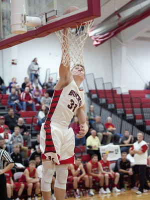 Grant Loy finished a steal with a breakaway one-handed jam against Bucyrus last Wednesday.