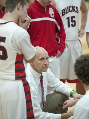 Buckeye Central coach Phil Loy listens to his players during a timeout against Bucyrus