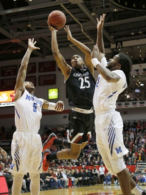 UC guard Kevin Johnson (9 points) was among several Bearcats who scored above their season averages Thursday, in a fast-paced 76-72 win over Memphis.