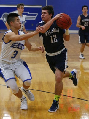 Jeff Zhou (3) of Holmdel defends against Shane Flanagan (12) of Manasquan during boys basketball game at Holmdel High School. Holmdel,NJ. Tuesday, February 9, 2016.