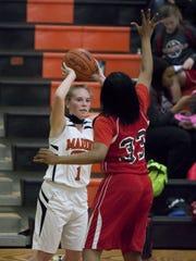 Marine City junior Antonia Potvin looks to pass during