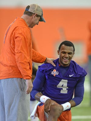 Clemson coach Dabo Swinney jokes with quarterback Deshaun Watson on the Tigers' opening day of spring practice.