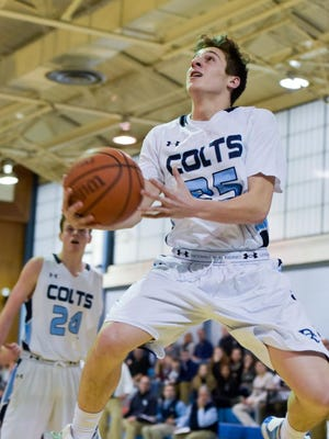 Nick Mugavero (25) of CBA tries a reverse layup. Donovan played CBA in boys basketball at CBA in Lincroft, NJ, on Friday, March 4, 2016. /