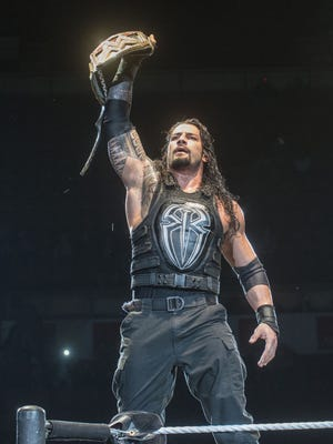 Shannon Heupel/Advertiser file Roman Reigns will try to regain the WWE world title at Wrestlemania 32.