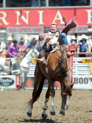 George Gillespie from Hamilton, Mont., hangs on at the 2016 California Rodeo Salinas.
