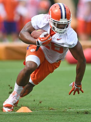 Clemson running back Adam Choice goes through drills during the Tigers' fall camp.