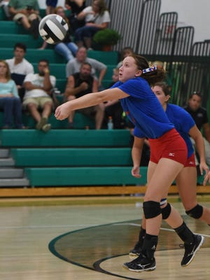Zane Trace's Evie Bennett receives a serve against Huntington in a match earlier this season. Bennett, just a sophomore, has a been a major plus for the Pioneers this year.