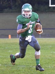 Huntington's Elijah McCloskey carries the ball during a game against Adena at Huntington High School