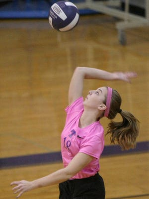 "TCA""s Lauren Petty serves the ball against Trenton Peabody in a Class A sectional."