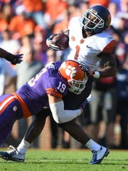 Clemson's Tanner Muse (19) wraps up Syracuse return specialist Brisly Estime on Nov. 5.