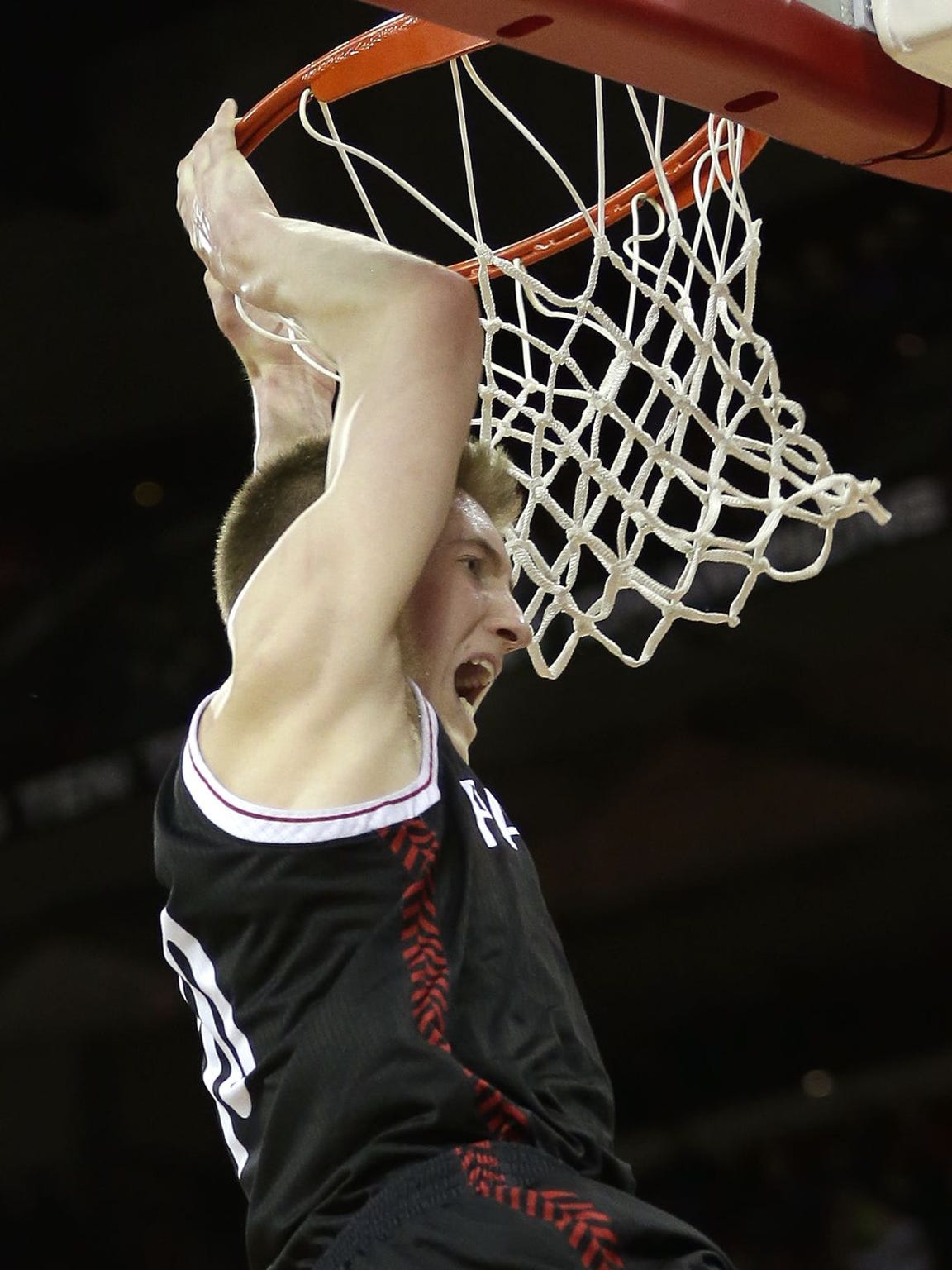 SPASH's Sam Hauser yells to fans following a dunk against