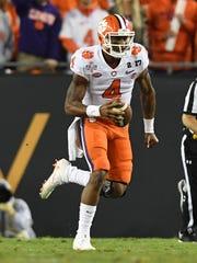 Clemson quarterback Deshaun Watson runs for a big gain
