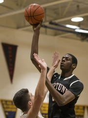 Neptune junior center Jared Kimbrough shoots over Marlboro