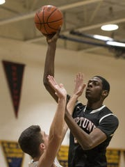 Neptune's Jared Kimbrough takes a shot as he is guarded