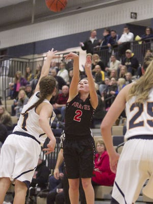 Chloe Hanifan of Pinckney (center) scored nine points to help her team beat Saline and earn its first district victory in 12 seasons.