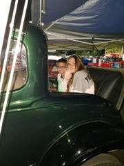 A photo of 10-year-old Nolan Kimbrough and his sister Charly Kimbrough, 13, sitting in a 1931 Ford Model A pickup truck.