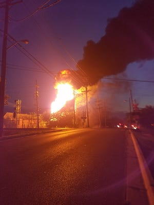 Large flames and a huge plume of smoke were visible from a distance.