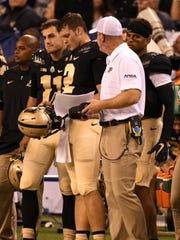 Purdue coach Jeff Brohm speaks to quarterback Elijah Sindelar (2) and David Blough during the Sept. 2 game against Louisville