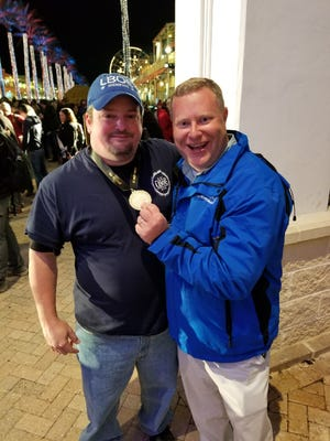 Jimmy Shotwell (right), host of The Rub, congratulates Tommy Shive of LBOE for their first place finish in burgers at The World Food Championships.