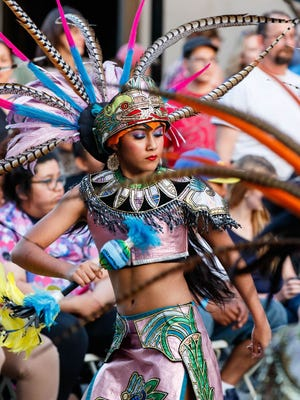 Dancer Izabella Luevano, 13, from the Dance Academy of Mexico (Milwaukee) performs during Waukesha's Friday Night Live event on June 2, 2017. The group is performing at World Refugee Day at the Westown Farmers Market.