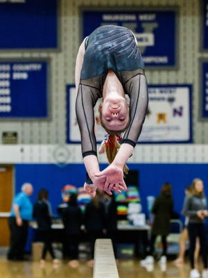 Mukwonago/Kettle Moraine gymnast Malia Christiansen competes on beam during the Classic 8/Southeast Conference meet Thursday, Feb. 16, 2017.