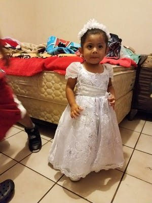 Elizabeth Sebastian, 2, on the day of her baptism. Elizabeth drowned in an Immokalee apartment complex pool Saturday afternoon.