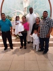 Elizabeth Sebastian, 2, on the day of her baptism with her mother (in pink) and her father (far right). Elizabeth drowned in an Immokalee apartment complex pool Saturday afternoon.