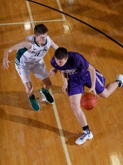 Fowlerville's Brendan Young, right, made first-team all-county as a freshman last season.