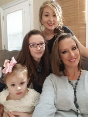 Christina Dunaway with her daughters Alexis, 17, Paige, 14, and Jesslynn, 2.