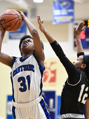 Eastside's Kennedy Taylor, left, powers her way toward the basket as Greer's Sierra Carter defends Tuesday night. Taylor scored 23 points in the Eagles' 49-48 loss.
