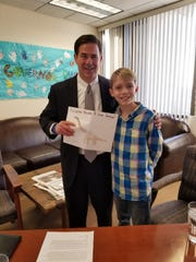 Jax Weldon, 11, meets with Gov. Doug Ducey. Jax wrote