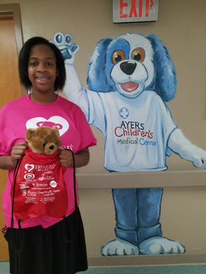 Treasure Thaxton holds a bead just before entering the Ayers Children's Medical Center at Jackson General Hospital.