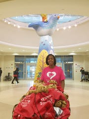 Treasure Thaxton pushes a cart of teddy bears at Le Bonheur Children's Hospital on Wednesday.