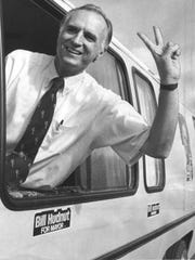 "William Hudnut flashes a ""V for victory"" sign when he pulls into the parking lot of Middle Keystone School on Election Day in 1975. Hudnut defeated Democrat Robert Welch in the race for Indianapolis mayor."