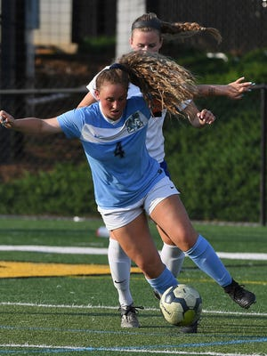 Lindsay White (4) is one of four players from state champion J.L. Mann on the Class AAAAA girls soccer all-state team.