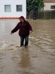 Jason Levine navigates flood water on Main Street in Augusta Tuesday morning.