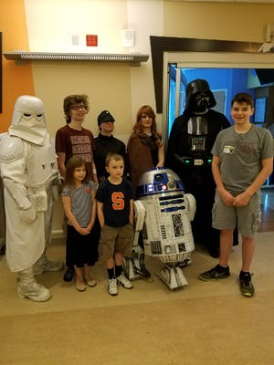 On May 4, Jake DeVries and his siblings posed with Star Wars characters at Upstate Golisano Children's Hospital in Syracuse.