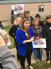 Elissa Slotkin, the Democratic challenger to U.S. Rep. Mike Bishop, R-Rochester, in the 2018 midterm elections, speaks to supporters before going in to vote at her precinct.