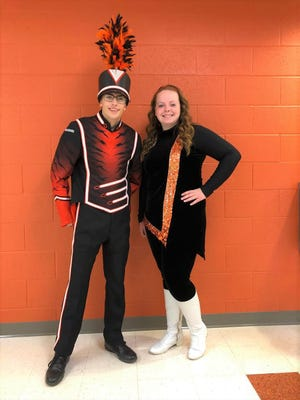 Luke Burk and Makayla Reiger show off the new Strasburg band uniforms.