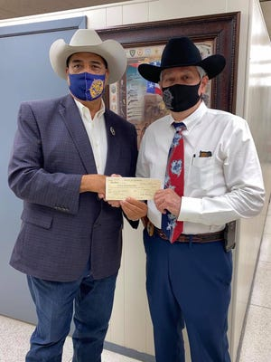 JWC Sheriff Daniel Bueno presented Brooks County Sheriff Benny Martinez with a check for over $79,000.